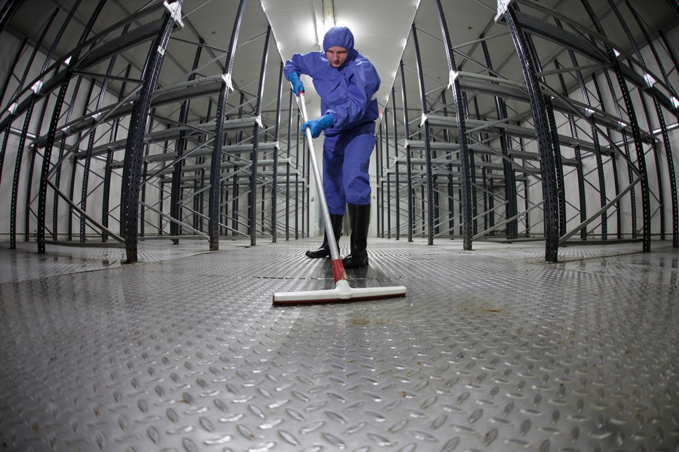 Cleaning the floor of an industrial building